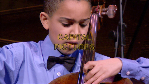 Talent Has Hunger (2015) <br /> Musical prodigy and cellist Lev Mamuya performs at a recital<br /> *Filmstill - Editorial Use Only*<br /> CAP/KFS<br /> Image supplied by Capital Pictures