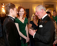 07 February 2019 - Prince Charles, Prince Of Wales speaks with actress Eleanor Tomlinson and her Brother Ross Tomlinson during the Prince's Trust Invest In Futures Reception at The Savoy Hotel in London. Over the past 13 years, The Princes Trusts 'Invest in Futures' event has encouraged donors to help disadvantaged young people into work, training or enterprise. Photo Credit: ALPR/AdMedia