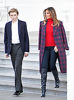 First lady Melania Trump and son Barron walk to accept the White House Christmas tree on the North Portico of the White House in Washington, DC on Monday, November 20, 2017.  The tree will stand in the Blue Room.<br /> Credit: Ron Sachs / CNP /MediaPunch /NortePhoto.com