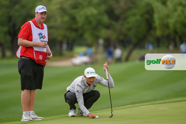 HaoTong Li (CHN) lines up his putt on 12 during day 4 of the Valero Texas Open, at the TPC San Antonio Oaks Course, San Antonio, Texas, USA. 4/7/2019.<br /> Picture: Golffile | Ken Murray<br /> <br /> <br /> All photo usage must carry mandatory copyright credit (© Golffile | Ken Murray)