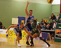 Brendon Polybank tries to steal off Keith Davis (right) as Nick Horvath awaits the outcome during the NBL Round 14 match between the Manawatu Jets  and Wellington Saints. Arena Manawatu, Palmerston North, New Zealand on Saturday 31 May 2008. Photo: Dave Lintott / lintottphoto.co.nz