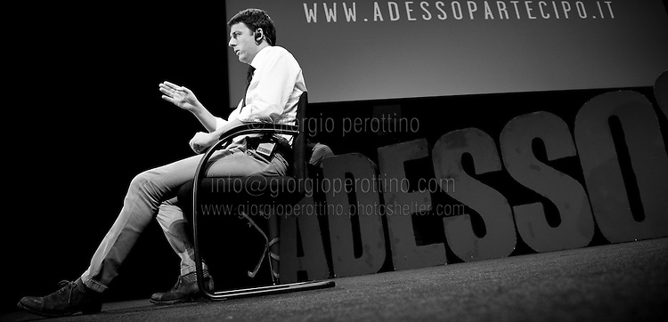 Matteo Renzi gestures during a TV interview after his speech at a political campaign convention for the Partito Democratico's primary elections -Italian left wing Party - in Turin, October 21, 2012.