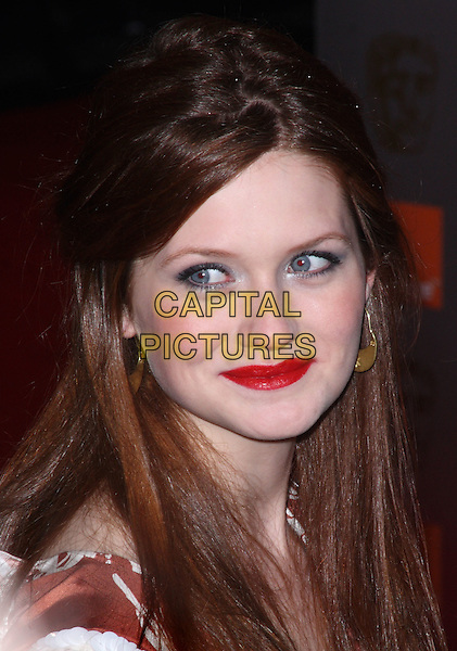 BONNIE WRIGHT.Orange British Academy Film Awards at the Royal Opera House, Covent Garden, London, England..February 13th, 2011.arrivals BAFTA headshot portrait white brown print silk satin beige sleeveless gold earrings red lipstick .CAP/JIL.©Jill Mayhew/Capital Pictures