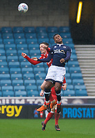 Mahlon Romeo of Millwall wins the header from Barrie McKay of Nottingham Forest during the Sky Bet Championship match between Millwall and Nottingham Forest at The Den, London, England on 30 March 2018. Photo by Alan  Stanford / PRiME Media Images.