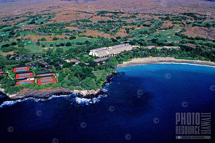 Aerial shot of the luxurious Mauna Kea Beach Hotel and coastline on the Big Island of Hawaii.