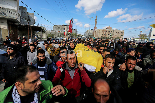 Mourners carry the body of Palestinian farmer Mahdi Ermelat, 36, during his funeral in Rafah in the southern Gaza Strip January 19, 2020. Ermelat, was announced dead in the explosion while another man was critically injured, and was moved to nearby Abu Yousef Al-Najjar Hospital for treatment. Photo by Ashraf Amra