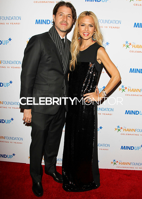BEVERLY HILLS, CA, USA - NOVEMBER 21: Rodger Berman, Rachel Zoe arrive at Goldie Hawn's Inaugural 'Love In For Kids' Benefiting The Hawn Foundation's MindUp Program held at Ron Burkle's Green Acres Estate on November 21, 2014 in Beverly Hills, California, United States. (Photo by Celebrity Monitor)