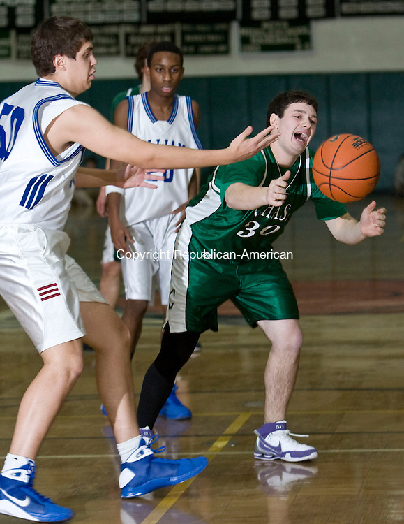 WATERBURY, CT - 26 JANUARY 2009 -012609JT13-<br /> Chase Collegiate's Evan Patchen and Williams' Noah Spigelman scramble for a loose ball during Monday's game at Chase. In the background is Williams' Kolton Harris. Chase won 63-47.<br /> Josalee Thrift / Republican-American