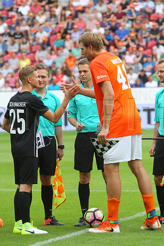 July 3rd 2017, Mainz, Germany;  Mick Schumacher (L), the son of the retired Formula One driver Michael Schumacher, and basketball player Dirk Nowitzki shake hands ahead of a football benefit match in honour of Michael Schumacher in the Opel Arena in Mainz, Germany, 3 July 2017.  The match was organised for Champions for Charity which donated for Dirk Nowitzki Foundation and for Schumacher's Keep Fighting Initiative