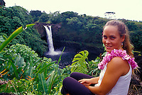 Lovely young woman ( 24) wearing a orchid flower lei at Rainbow falls, just outside of Hilo on the Big island of Hawaii