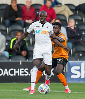 Modou Barrow of Swansea City holds off Fumnaya Shomotun of Barnet during the 2017/18 Pre Season Friendly match between Barnet and Swansea City at The Hive, London, England on 12 July 2017. Photo by Andy Rowland.
