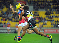 James Gwilt takes a mark under pressure during the ANZAC Day AFL match between St Kilda Saints and Brisbane Lions at Westpac Stadium, Wellington, New Zealand on Friday, 25 April 2014. Photo: Dave Lintott / lintottphoto.co.nz