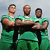 Jordan McLune, Farmingdale running back, center, poses for a portait alongside teammates Corey Hill, left, and Kevin Eversley at Newsday headquarters on Thursday, Aug. 25, 2016.