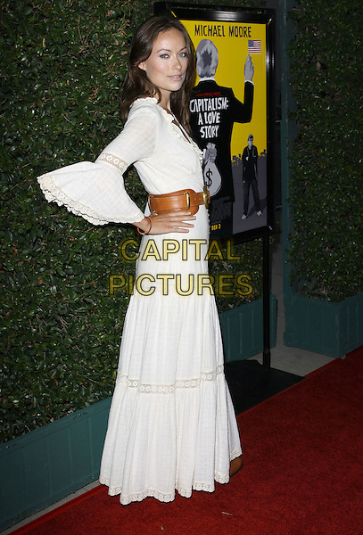 "OLIVIA WILDE.""Capitalism: A Love Story"" Los Angeles Premiere held At AMPAS Samuel Goldwyn Theater, Beverly Hills, California, USA..September 15th, 2009.full length white maxi dress brown leather belt gypsy hands on hips sleeves .CAP/ADM/KB.©Kevan Brooks/AdMedia/Capital Pictures."