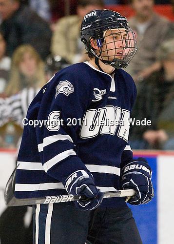 Trevor van Riemsdyk (UNH - 6) - The Harvard University Crimson defeated the University of New Hampshire Wildcats 7-6 on Tuesday, November 22, 2011, at Bright Hockey Center in Cambridge, Massachusetts.