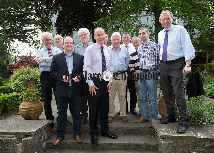 Fianna Fail leader Micheal Martin with supporters while canvassing for a YES vote in Ennis last week. Photograph by John Kelly.