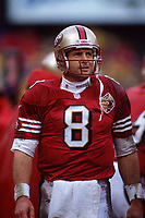 SAN FRANCISCO, CA:  Quarterback Steve Young of the San Francisco 49ers stands on the field in the rain during the NFC playoff game against the Philadelphia Eagles at Candlestick Park in San Francisco, California on December 29, 1996. (Photo by Brad Mangin)