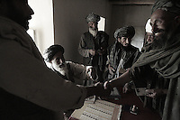 Afghan villagers show  go through the voting process in the village of Tsenan, Dey Chapon district, zabul province, Afghanistan on september 18 2005..More than 5000 villagers from the Dey Chapon valley were registerd to vote for the parlamentar elections. about 800 actually reached the pole and voted. it's a great success for this district in Zabul, considered by the US military the most taliban populated in the country. for the 2004 presidential elections only 34 aghans from this district voted. 31 of them were from the afghan national army and afghan national police.