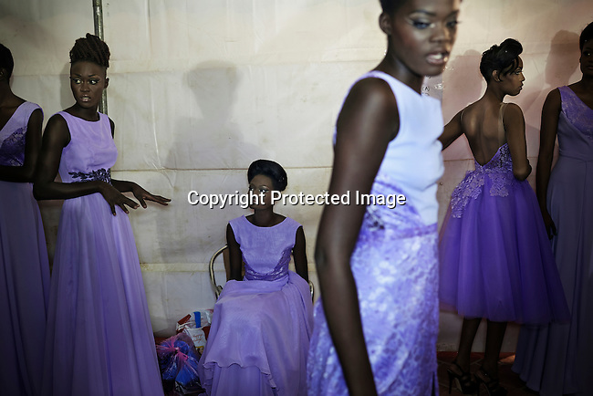 DAKAR, SENEGAL - JUNE 21: Models wait backstage before a fashion show at Dakar Fashion Week on June 21, 2014, at Hotel des Almadies in Dakar, Senegal. Seventeen Senegalese, African and foreign-based designers showed their collections during the 12th edition of Dakar Fashion week. (Photo by Per-Anders Pettersson)