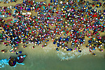 """Hundreds of fishermen gather on a beach after a night fishing on the open ocean as locals flock around their brightly coloured buckets of squid, shrimp and crabs to buy the freshest seafood.  The men only head out to sea during the summer months in the Nui Thanh district in Quang Nam, Vietnam.<br /> <br /> Photographer Khanh Phan, who captured the beautiful pictures of Tam Tien beach market with his drone, said: """"This is a bustling, lively place - many boats leave from here to go out to sea.  SEE OUR COPY FOR DETAILS.<br /> <br /> Please byline: Khanh Phan/Solent News<br /> <br /> © Khanh Phan/Solent News & Photo Agency<br /> UK +44 (0) 2380 458800"""
