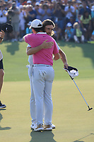 Tommy Fleetwood (ENG) & Rory McIlroy (NIR) in action on the 18th green during the final round of the DP World Championship, Earth Course, Jumeirah Golf Estates, Dubai, UAE. 24/11/2019<br /> Picture: Golffile | Phil INGLIS<br /> <br /> <br /> All photo usage must carry mandatory copyright credit (© Golffile | Phil INGLIS)