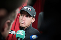 Greg Van Avermaet (BEL/BMC) gives some interviews from the team bus after the race as he was bombed by a doping accusation that very moment by newspaper Het Nieuwsblad itself<br /> <br /> Omloop Het Nieuwsblad 2015