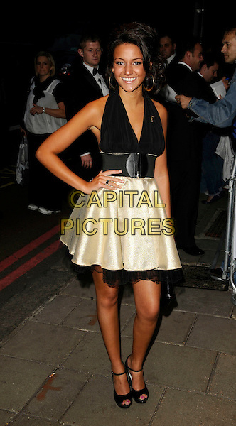 MICHELLE KEEGAN.The TVQuick & TVChoice Awards, Dorchester Hotel, London, England. .September 8th, 2008 .tv quick choice full length black halterneck dress top skirt gold clutch bag belt shoes mary janes chiffon hand on hip .CAP/CAN.©Can Nguyen/Capital Pictures.