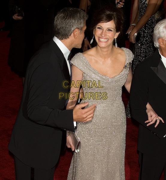 "GEORGE CLOONEY & JULIA ROBERTS .Costume Institute Gala - ""Superheroes: Fashion and Fantasy"" at The Metropolitan Museum of Art, New York, NY, USA..May 5th, 2008 .half length 3/4 balck tuxedo gold silver beige off the shoulder dress smiling .CAP/LNC/TOM.©TOM/LNC/Capital Pictures."