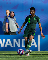 GRENOBLE, FRANCE - JUNE 22: Halimatu Ayinde #18 passes the ball during a game between Nigeria and Germany at Stade des Alpes on June 22, 2019 in Grenoble, France.