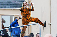 Pictured: A man in a tiger onesie outfit takes a picture on the Esplanade, Tenby. Sunday 15 September 2019<br /> Re: Ironman triathlon event in Tenby, Wales, UK.