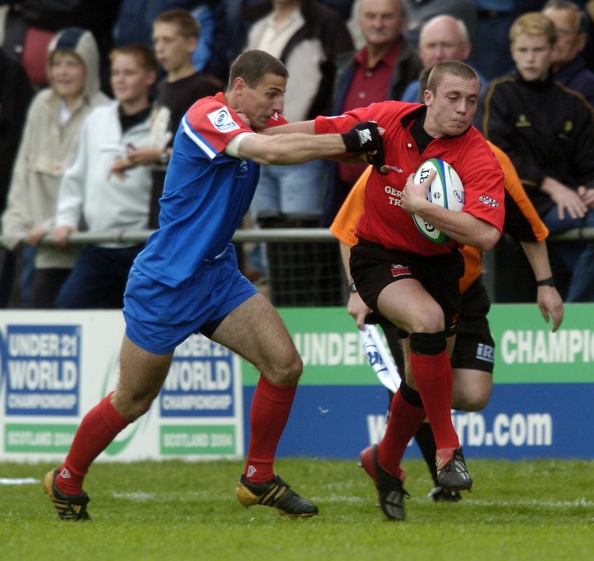 Photo. Jed Wee..Wales U21 v Russia U21, IRB U21 World Championship, 11/06/2004..Wales' Richard Rees (R) with Russia's Alexei Yandolskiy.