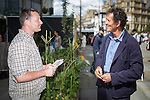 © Joel Goodman - 07973 332324 . 3 August 2013 . Cathedral Street , Manchester , UK . Monty Don (right) meets Mark Frith of Hulme Community Gardens at the festival . Dig the City urban gardening festival . Photo credit : Joel Goodman