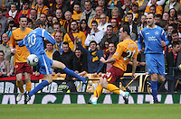 Francis Jeffers passes the ball before being fouled by Murray Davidson