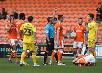 Fleetwood Town's Nathan Sheron is shown a red card by Referee Darren Bond for a tackle on Blackpool's Matty Virtue<br /> <br /> Photographer Stephen White/CameraSport<br /> <br /> The EFL Sky Bet League One - Blackpool v Fleetwood Town - Monday 22nd April 2019 - Bloomfield Road - Blackpool<br /> <br /> World Copyright © 2019 CameraSport. All rights reserved. 43 Linden Ave. Countesthorpe. Leicester. England. LE8 5PG - Tel: +44 (0) 116 277 4147 - admin@camerasport.com - www.camerasport.com