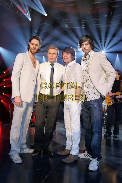 TAKE THAT - JASON ORANGE, GARY BARLOW, MARK OWEN & HOWARD DONALD.Perform live on TV CD Live, Milan, Italy..January 17th, 2007.group band music full length white suit trousers jacket jeans denim.CAP/OME.© Capital Pictures.