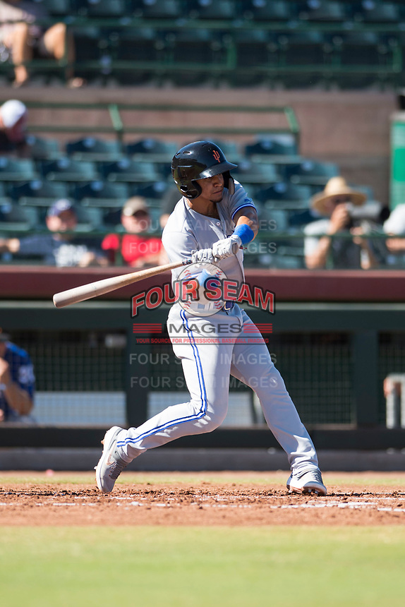 Surprise Saguaros shortstop Santiago Espinal (6), of the Toronto Blue Jays organization, swings at a pitch during an Arizona Fall League game against the Scottsdale Scorpions at Scottsdale Stadium on October 26, 2018 in Scottsdale, Arizona. Surprise defeated Scottsdale 3-1. (Zachary Lucy/Four Seam Images)