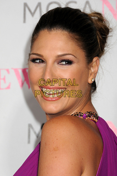 DAISY FUENTES.MOCA's 30th Anniversary Gala held at MOCA, Los Angeles, California, USA..November 14th, 2009.full length purple pink sleeveless fuschia gold beads smiling looking over shoulder .CAP/ADM/BP.©Byron Purvis/AdMedia/Capital Pictures.