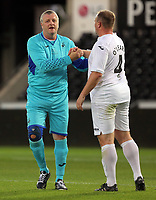 (L-R) Roger Freestone is greeted by team mate Kristian O'Leary of Swansea during the Swansea Legends v Manchester United Legends at The Liberty Stadium, Swansea, Wales, UK. Wednesday 09 August 2017