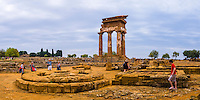 Panoramic photo of tourists at The Valley of the Temples (Valle dei Templi), Temple of Castor and Pollux, Agrigento, Sicily, Italy, Europe. This is a panoramic photo of tourists at the ruins of The Temple of Castor and Pollux at The Valley of the Temples (Valle dei Templi). Valley of the Temples (Valle de Temple) and thus The Temple of Castor and Pollux, are a UNESCO World Heritage Site on the South Coast of Sicily, Italy.