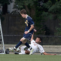Boston College defender/forward Kevin Mejia (12) slide tackle on Quinnipiac University midfielder Tim Quigley (13). Boston College defeated Quinnipiac, 5-0, at Newton Soccer Field, September 1, 2011.
