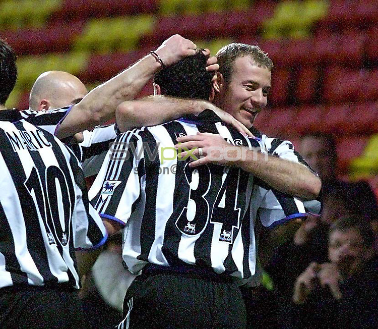Watford v Newcastle...FA Premiership...20/11/99.COPYWRIGHT PICTURE>>SIMON WILKINSON>>01943 436649..England captain Alan Shearer congratulates Nicolas Dabizas on scoring against Watford.