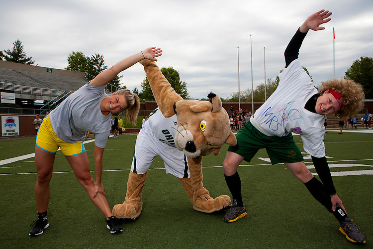 Rufus helps Allison Thournburgh, left and Jed DeBruin warm up for the Race for the Reason at Peden Stadium Saturday.