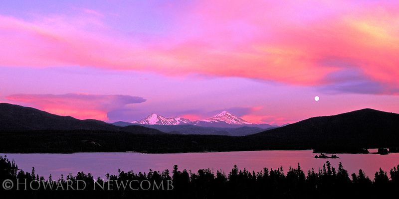 A blast of colors as sunset and moonrise occur together over Dillon Resevoir, Summit County, Colorado.