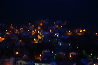 Here, an artistic, colorful view from the top oh the upland where is located the historical center of Lugnano in Teverina to the new part of the little town, on the bases of the near mountain. The photo is taken in the night, and the fact that it is blurry gives back a nice game of lights, made by the street-lamps.<br /> <br /> You can download this file for (E&amp;PU) only, but you can find in the collection the same one available instead for (Adv).