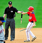 1 March 2011: The Washington Nationals' Bat Boy picks up a broken bat in the infield during a Spring Training game against the New York Mets at Space Coast Stadium in Viera, Florida. The Nationals defeated the Mets 5-3 in Grapefruit League action. Mandatory Credit: Ed Wolfstein Photo