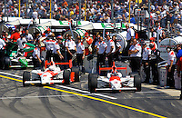 "Carburation Day for the 87th Indianapolis 500, Indianapolis Motor Speedway, Speedway, Indiana, USA  22 May,2003.Gil deFerran (L) and Helio Castroneves pull from their pits for  ""Carb Day"" practice..World Copyright©F.Peirce Williams 2003 .ref: Digital Image Only..F. Peirce Williams .photography.P.O.Box 455 Eaton, OH 45320.p: 317.358.7326  e: fpwp@mac.com.."
