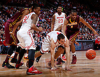 Ohio State Buckeyes guard Aaron Craft (4) and Minnesota Golden Gophers guard Andre Hollins (1) chase a loose ball during the first half of the NCAA men's basketball game between the Ohio State Buckeyes and the Minnesota Golden Gophers at Value City Arena in Columbus, Ohio, on Saturday, Feb. 22, 2014. At the end of the first half, Minnesota led Ohio State, 28-18. (Columbus Dispatch/Sam Greene)