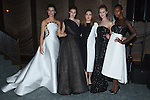 Fashion designer Elizabeth Kennedy poses with models at the close of her Elizabeth Kennedy Fall Winter 2016 collection fashion show, during New York Fashion Week Fall 2016.
