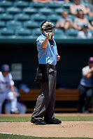 Umpire Austin Jones calls a strike during a Southern League game between the Tennessee Smokies and Jacksonville Jumbo Shrimp on April 29, 2019 at the Baseball Grounds of Jacksonville in Jacksonville, Florida.  Tennessee defeated Jacksonville 4-1.  (Mike Janes/Four Seam Images)