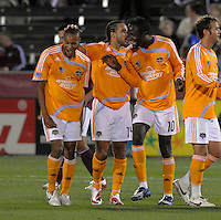 Ricardo Clark, Dwayne De Rosario, and Kei Kamara (left to right) celebrate Clark's goal. The Houston Dynamo defeated the Colorado Rapids 3-1 at Dick's Sporting Goods Park, Denver, Colorado. Saturday, October 4, 2008. Photo by Trent Davol/isiphotos.com.